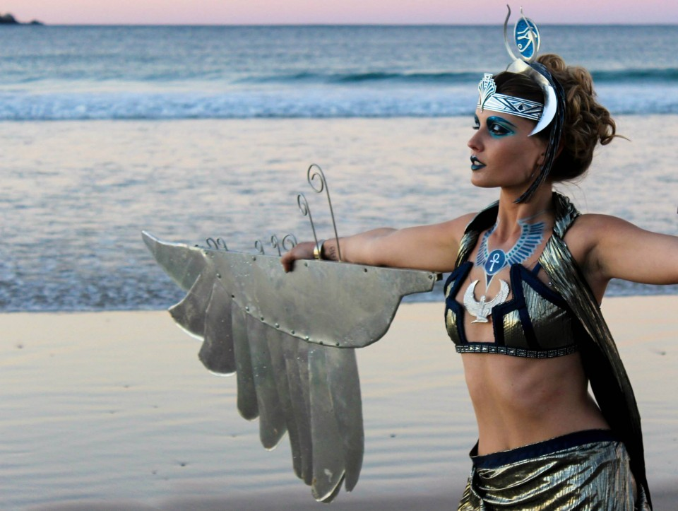 ISIS on the beach of Byron Bay at The Byron Bays International Fashion Festival for Eye Of Horus Cosmetics photography ELEGANT SOLUTIONS PHOTOGRAPHY / mua & head piece ELVIS SCHOULIANOFF / costume & wings LOUISE LASSAY / model KAIT PROVAN